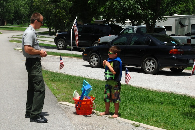 Park Ranger Phillip Sliger greets a kid wearing a life jacket at Defeated Creek Campground during a past recreation season. The campground at Cordell Hull Lake is one of 25 campgrounds at eight lakes the U.S. Army Corps of Engineers Nashville District operates every recreation season. The public is encouraged to begin reserving for the 2017 recreation season at www.recreation.gov.