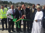 DLA Energy Commander Air Force Brig. Gen. Martin Chapin cuts the ribbon to officially open DLA Distribution's new material processing center in Salalah, Oman Feb. 9.