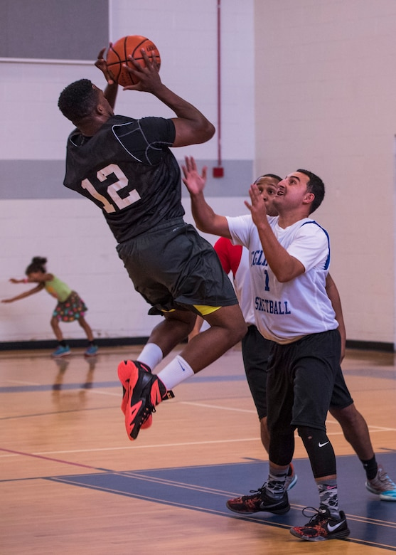 Stephan Atrice, Armament Directorate, jumps to make a basket during the intramural basketball championship March 6 at Eglin Air Force Base Fla. The EB team defeated the 53rd Wing team 53-42 to take the trophy. (U.S. Air Force photo/Ilka Cole)