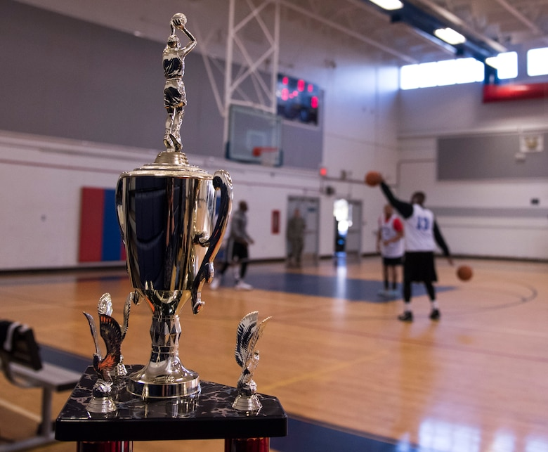 The trophy for the intramural basketball championship sits courtside during the warm-up period before the game March 6 at Eglin Air Force Base Fla. The Armament Directorate team defeated the 53rd Wing team 53-42 to take the trophy. (U.S. Air Force photo/Ilka Cole)