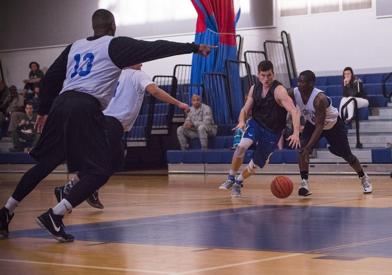 David Adler, Armament Directorate and a 53rd Wing competitor, race toward the ball during the intramural basketball championship March 6 at Eglin Air Force Base Fla. The EB team defeated the 53rd Wing team 53-42 to take the trophy. (U.S. Air Force photo/Ilka Cole)