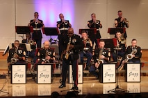 Chief Warrant Officer 2 Demarius Jackson, band director, 2nd Marine Aircraft Wing, performs a solo during a concert with the Marine Corps Jazz Orchestra at California State University Sacramento, March 10, 2017. The orchestra features top Marine musicians from throughout the Corps. They tour annually to share their music, culture, and patriotism with public audiences. This year's concert was their first performance in Sacramento. (U.S. Marine Corps photo by Staff Sgt. Jacob Harrer)