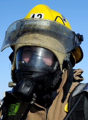 Dustin Bazille, Kenmore fire department firefighter, at Minot Air Force Base, N.D., Feb. 24, 2017. The Minot AFB fire department hosted training with local fire departments, scenarios included simulated helicopter fire and missile field response. (U.S. Air Force photo/Staff Sgt. Chad Trujillo)