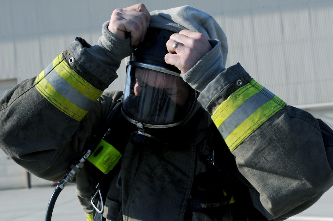 Tim McCartney North Lemmon fire department firefighter, takes off his mask at Minot Air Force Base, N.D., Feb. 24, 2017 The Minot AFB fire department hosted training with local fire departments, scenarios included simulated helicopter fire and missile field response. (U.S. Air Force photo/Staff Sgt. Chad Trujillo)