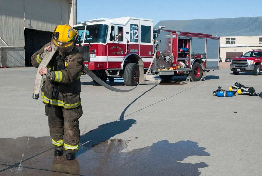 Tim McCartney, North Lemmon Fire Department firefighter, carries a fire hose at Minot Air Force Base, N.D., Feb. 24, 2017. The Minot AFB 5th Civil Engineer Squadron hosted a North Dakota Fire Association training class for mutual aid fire departments. (U.S. Air Force photo/Airman 1st Class Jonathan McElderry)