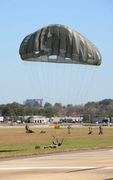 Members of the Leadership Cobb program observed Paratroopers from Company H 121st IN performing jump training maneuvers from a C-130 Hercules aircraft assigned to the 94th Airlift Wing, during a tour of Dobbins Air Reserve Base, Ga. March 8, 2017. (U.S. Air Force photo/Don Peek)