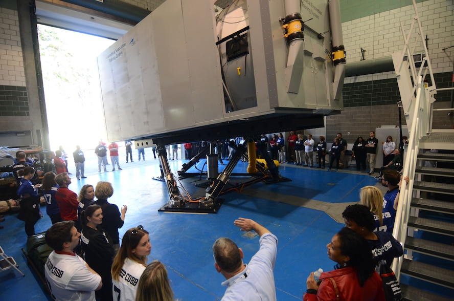 Members of the Leadership Cobb program witness the first public in-motion demonstration of the Aeromedical Evacuation Training System during a tour of Dobbins Air Reserve Base, Ga. March 8, 2017.  The medical simulator is operated by the 94th Aeromedical Evacuation Squadron personnel and is designed to provide realistic training scenarios encountered by AES personnel. (U.S. Air Force photo/Don Peek)