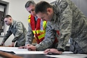 Members of the Emergency Management team look over a base map during a table top exercise held on March, 4, 2017 by the Emergency Operations Center here. EM holds regular exercises and scenarios to ensure and improve readiness among base personnel. (U.S. Air Force photo/Senior Airman Joshua Kincaid)