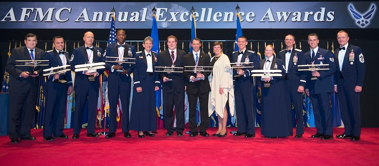 Air Force Materiel Command annual award winners are joined on stage by Gen. Ellen M. Pawlikowski, AFMC commander; Chief Master Sgt. Jason L. France, AFMC command chief; and, Patricia M. Young, AFMC executive director, at the end of the command's annual awards banquet March 8, 2017, in the National Museum of the U.S. Air Force at Wright-Patterson Air Force Base, Ohio. Active-duty and civilian Airmen from AFMC centers across the country came together to learn who would be named the best in their nine respective categories for 2016. (U.S. Air Force photo/R.J. Oriez)