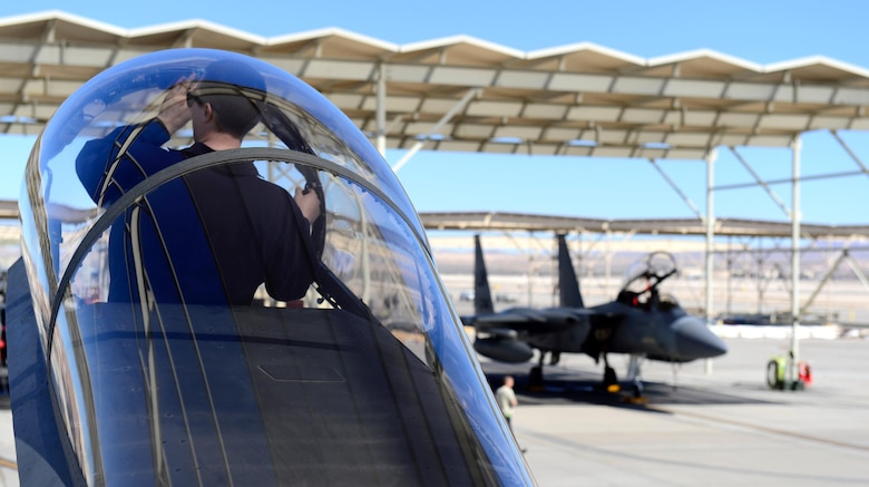 A 493rd Aircraft Maintenance Unit Airman from Royal Air Force Lakenheath, England, prepares an F-15C Eagle during exercise Red Flag 17-2 at Nellis Air Force Base, Nev., Mar. 3. Red Flag provides an opportunity for the 493rd Fighter Squadron aircrew and maintainers to enhance their tactical operational skills alongside military aircraft from coalition forces.(U.S. Air Force photo/Senior Airman Malcolm Mayfield)