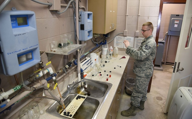 Staff Sgt. Shane Pentheny, 22nd Civil Engineer Squadron Water and Fuels System Maintenance technician, performs water-quality tests on water taken from several base buildings March 9, 2017, at McConnell Air Force Base, Kan. WFSM tests chlorine, fluoride and pH levels daily to ensure the base populace receives quality water. (U.S. Air Force photo/Airman 1st Class Erin McClellan)
