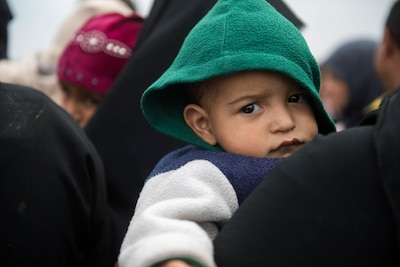 A child waits at a processing station for internally displaced people prior to being transported to refugee camps near Mosul, Iraq, March 3, 2017. Iraqi security forces are continuing operations in the western sector of Iraq's second-largest city to liberate it from Islamic State of Iraq and Syria control. Army photo by Staff Sgt. Alex Manne