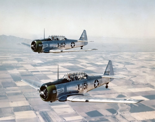 Two U.S. Air Force AT-6C's fly near Luke Field in 1943. The AT-6's were the first trainer aircraft flown by Luke in 1941. (Courtesy Photo)
