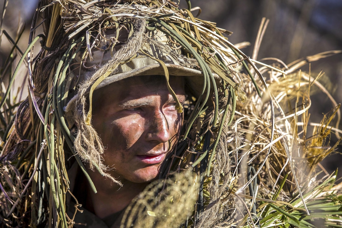 Marine Corps Lance Cpl. William Pearn maneuvers around a training area during a stalking exercise.