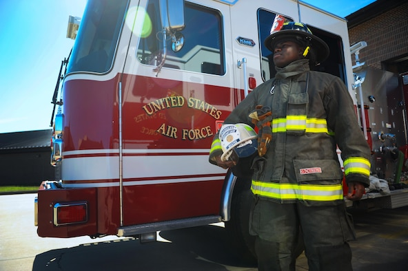 The 19th Civil Engineer Squadron Fire Department is composed of both military and civilian personnel that work as one team to protect life, property and environment within the boundaries of the Air Force installation.Military personnel wear the red and black helmet while civilian personnel wear white helmets. (U.S. Air Force photo by Airman 1st Class Codie Collins)