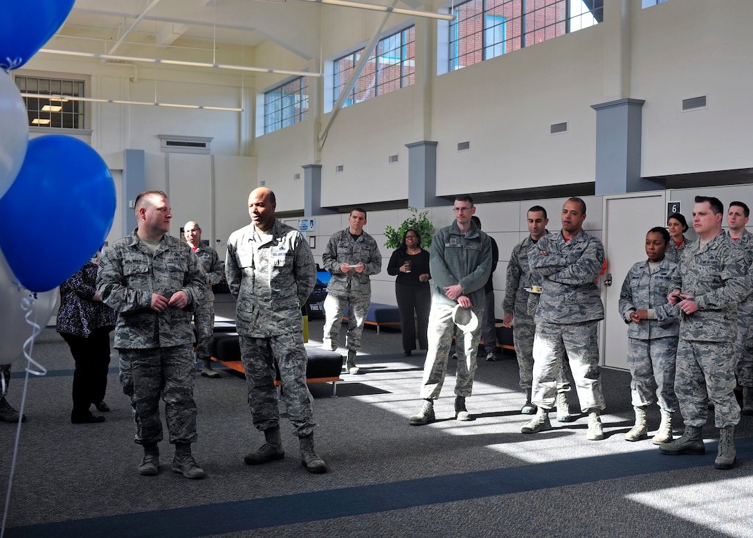 "Airmen assigned to Joint Base Lewis-McChord, Wash., watch a presentation about the Air Force Aid Society during the organization's 75th Anniversary Celebration, March 10, 2017 at the Military Personnel Section on McChord Field. AFAS dates back to 1942 when Gen. Henry ""Hap"" Arnold , Commanding General of the Army Air Forces, and his wife, Bee, turned the ideal of 'Airmen helping Airmen' into a reality. (U.S. Air Force photo/Staff Sgt. Whitney Amstutz)"