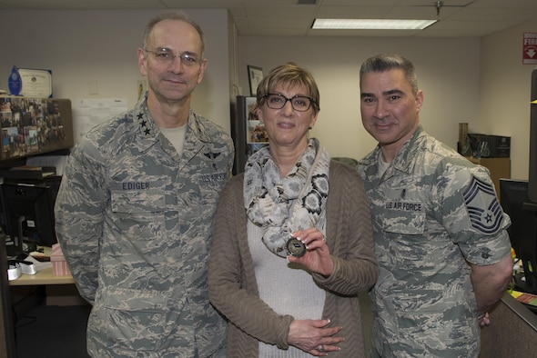 U.S. Air Force Lt. Gen. Mark Ediger, the Air Force surgeon general, Kathleen Lelevier, the 354th Medical Group bioenvironmental water program manager, and Chief Master Sgt. Edward Pace, the Medical Enlisted Forces chief, pose for a photo, March 10, 2017 at Eielson Air Force Base, Alaska. Ediger recognized Lelevier for her commitment to improving local water supplies. (U.S. Air Force photo by Airman Eric M. Fisher)
