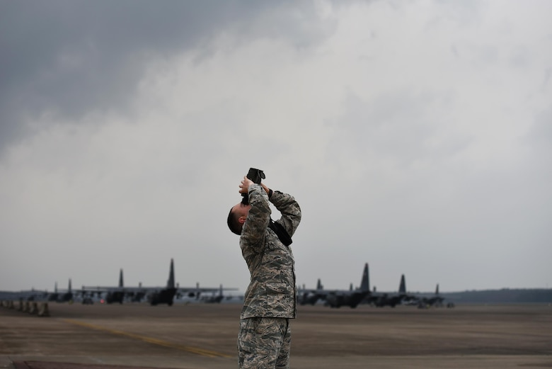 U.S. Air Force Airman 1st Class Jacob Phipps, 19th Operations Support Squadron Weather Flight journeyman, uses a laser range finder during a tornado watch Feb. 28, 2017, at Little Rock Air Force Base, Ark. As meteorologists, Airmen monitor weather patterns 24/7 to alert aircrews and base populace of severe weather conditions imminent in the local area. (U.S. Air Force photo by Airman 1st Class Kevin Sommer Giron)