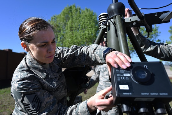 U.S. Air Force Master Sgt. April Stanford, 19th Operations Support Squadron Weather Flight Chief, works on a Tactical Meteorological Observing System March 8, 2017, at Little Rock Air Force Base, Ark. The equipment is a transportable system used in deployed locations to collect essential weather data for ground and flying operations. (U.S. Air Force photo by Airman 1st Class Kevin Sommer Giron)
