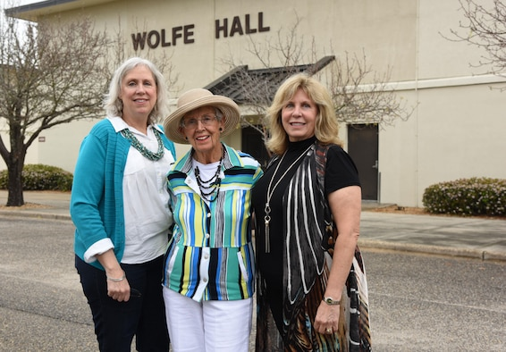 Jean Wolfe Zartman, daughter of Lt. Leroy Wolfe, and his  granddaughters, Nancy Hagy and Barbara Howard, pose for a photo in front of Wolfe Hall March 10, 2017, on Keesler Air Force Base, Miss. Wolfe's family received a tour of the facility and participated in a cake cutting ceremony at the building. Wolfe died in 1932 as the result of an airplane crash while assigned to the Philippines. (U.S. Air Force photo by Kemberly Groue)