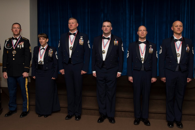 Army and Air Force service members are introduced to the audience at the Trail's End Event Center during a chief master sergeant and sergeant major induction ceremony on F.E. Warren Air Force Base, March 10, 2017. The induction ceremony recognizes those individuals who have achieved the highest rank in the enlisted force. (U.S. Air Force photo by Staff Sgt. Christopher Ruano)