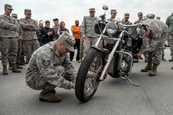 U.S. Air Force Tech. Sgt. Victor Estupinan, motorcycle rider, performs a pre-ride inspection checklist on his bike during an 18th Wing annual motorcycle safety brief March 9, 2017, at Kadena Air Base, Japan. Wing Safety and the Green Knights chapter 138 hosted the event to reinforce safety requirements and to promote mentorship opportunities for riders. (U.S. Air Force photo by Staff Sgt. Peter Reft/Released)