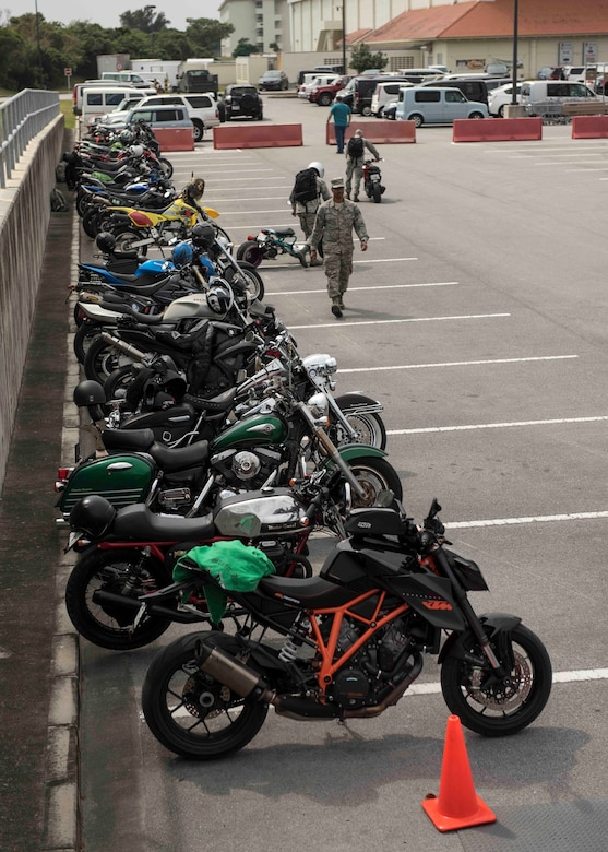 Motorcycles stand in a parking lot during an 18th Wing annual motorcycle safety brief March 9, 2017, at Kadena Air Base, Japan. Wing Safety and the Green Knights chapter 138 briefed riders on all legal requirements and also provided a skills practice course for participants to refresh fundamental and advanced riding techniques. (U.S. Air Force photo by Staff Sgt. Peter Reft/Released)