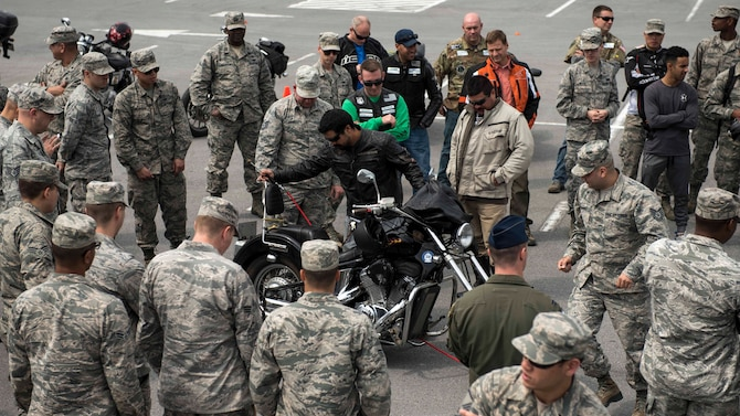 Members of Wing Safety perform a pre-ride inspection checklist with riders during an 18th Wing annual motorcycle safety brief March 9, 2017, at Kadena Air Base, Japan. Wing Safety and the Green Knights chapter 138 reminded riders of their legal responsibilities and also organized a motorcycle skills refresher course. (U.S. Air Force photo by Staff Sgt. Peter Reft/Released)
