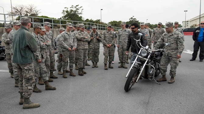 18th Wing Airmen and members of Wing Safety discuss motorcycle maintenance tips and tricks during a pre-ride inspection walkthrough during an 18th Wing annual motorcycle safety brief March 9, 2017, at Kadena Air Base, Japan. Riders of all experience levels came together to talk about motorcycle safety and to practice riding skills on a training course. (U.S. Air Force photo by Staff Sgt. Peter Reft/Released)