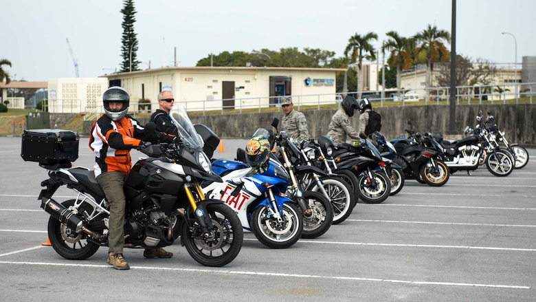 Riders stationed on Okinawa gear up for a motorcycle skills test course during an 18th Wing annual motorcycle safety brief March 9, 2017, at Kadena Air Base, Japan. Wing Safety and the Green Knights chapter 138 organized the event and reinforced safety riding standards for riders stationed on Okinawa. (U.S. Air Force photo by Staff Sgt. Peter Reft/Released)