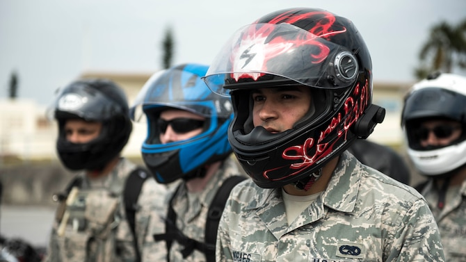 U.S. Air Force Senior Airman Alisson Moraes, motorcycle rider, listens to a skill course brief during an 18th Wing annual motorcycle safety brief March 9, 2017, at Kadena Air Base, Japan. Moraes and other riders stationed on Okinawa reviewed safety regulations and refreshed fundamental riding skills on a course set up by Wing Safety and the Green Knights chapter 138 motorcycle mentorship group. (U.S. Air Force photo by Staff Sgt. Peter Reft/Released)