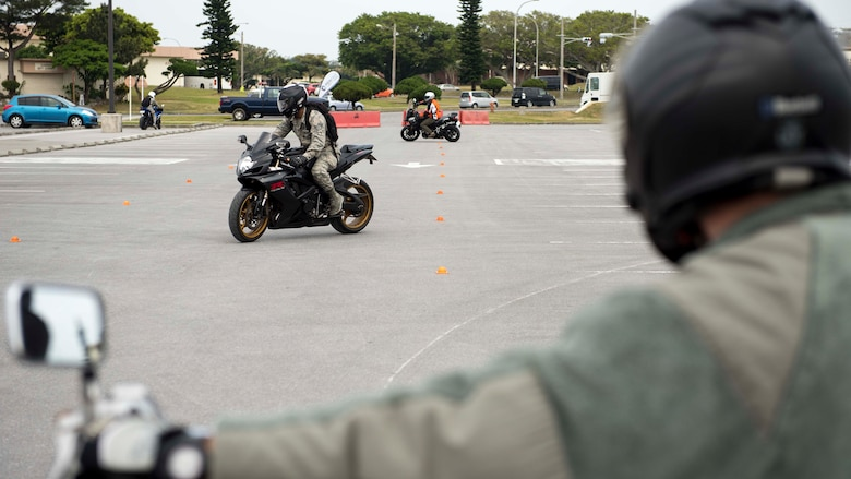 Motorcycle riders refresh their skills on a handling course during an 18th Wing annual motorcycle safety brief March 9, 2017, at Kadena Air Base, Japan. Wing Safety and the Green Knights chapter 138 hosted the event to reinforce safety regulations and help riders test their bike handling skills. (U.S. Air Force photo by Staff Sgt. Peter Reft/Released)