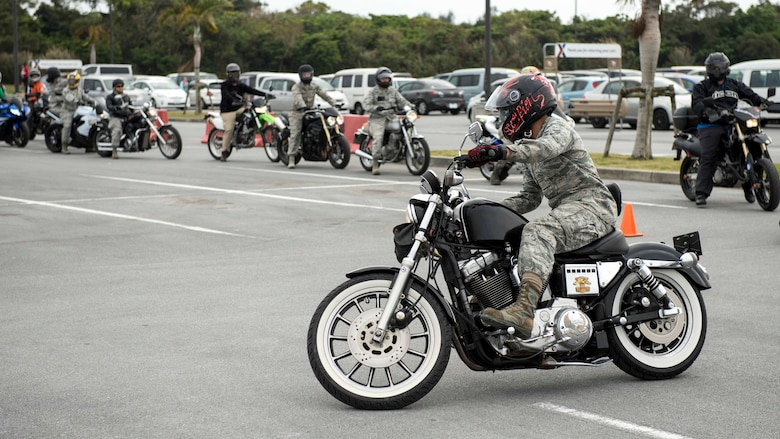 Motorcycle riders refresh their skills on a handling course during an 18th Wing annual motorcycle safety brief March 9, 2017, at Kadena Air Base, Japan. The Green Knights chapter 138 set up a skills test course to help riders improve their bike handling capabilities and to reinforce safety standards. (U.S. Air Force photo by Staff Sgt. Peter Reft/Released)