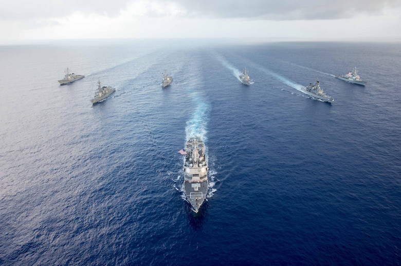 The Arleigh Burke-class guided-missile destroyer USS Mustin (DDG 89) leads U.S. Navy and Japan Maritime Self-Defense Force (JMSDF) ships in formation during MultiSail 17. MultiSail 17 is a bilateral training exercise improving interoperability between the U.S. and Japanese forces.  This exercise benefits from realistic, shared training enhancing our ability to work together to confront any contingency.