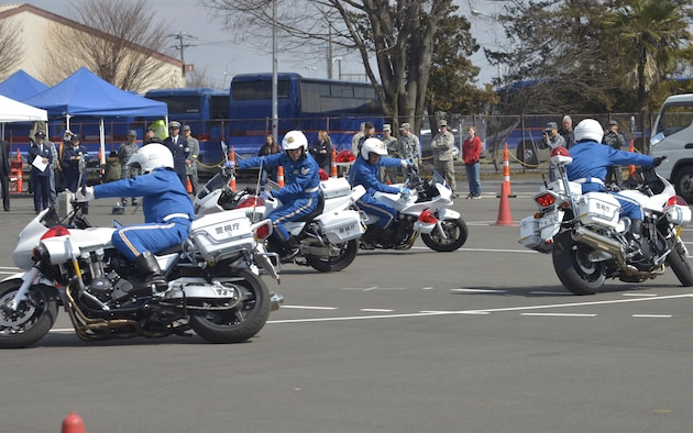 Members from the Tokyo Metro Police Motorcycle Demo team perform during the Yokota Safety and Readiness Festival at Yokota Air Base, Japan, March 10, 2017. The festival held an array of demonstrations and booths to encourage base residents and community members to apply risk management in their daily lives and provide information to assist them. (U.S. Air Force photo by Staff Sgt. David Owsianka)