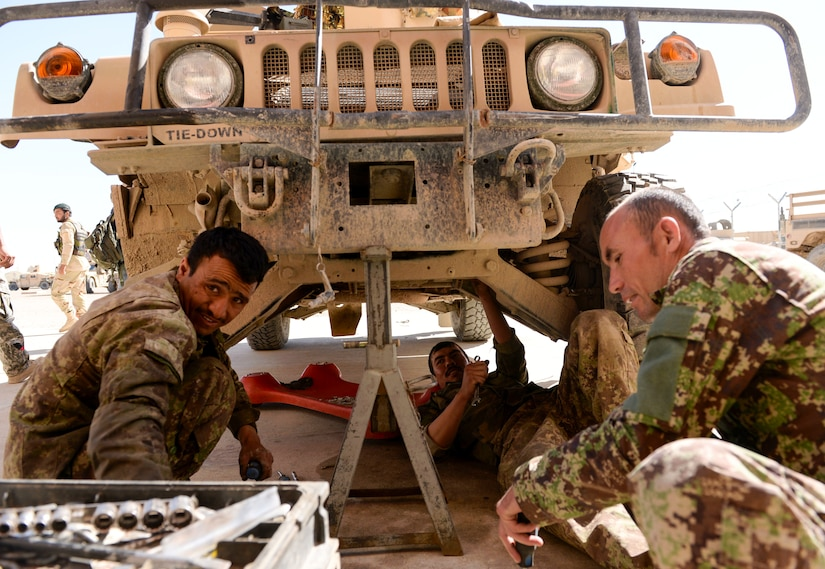 Afghan National Army 215th Corps mechanics work together to repair a Humvee in Helmand Province, Afghanistan, March 11, 2017. Helmand is one of Afghanistan's most contested provinces where maintenance and sustainment support are critical to the fight. (NATO photo by Kay M. Nissen)