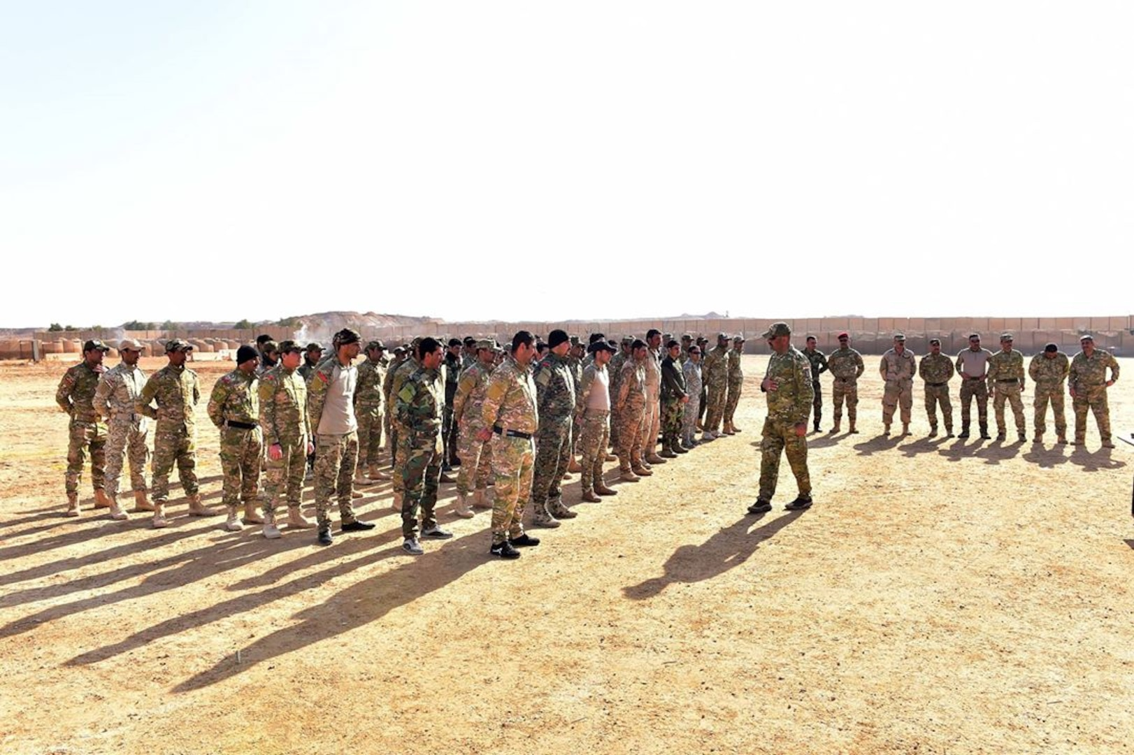 Col. Mohammad Hami Moussa, an Iraqi commander, inspects the first graduating company of a unique, multi-tribe Iraqi force, the A'ali Al Furat Brigade, at a training ground in Western Iraq, Jan 7, 2017. The A'ali Al Furat Brigade, which has nearly 200 fighters from more than 20 tribes - the first multi-tribe unit formed in Iraq, is the first recorded tribal unit to receive Law of Armed Conflict and rules of engagement training specifically from a U.S. military Judge Advocate General through coordination with Coalition partners. CJTF-OIR is the global Coalition to defeat ISIS in Iraq and Syria.