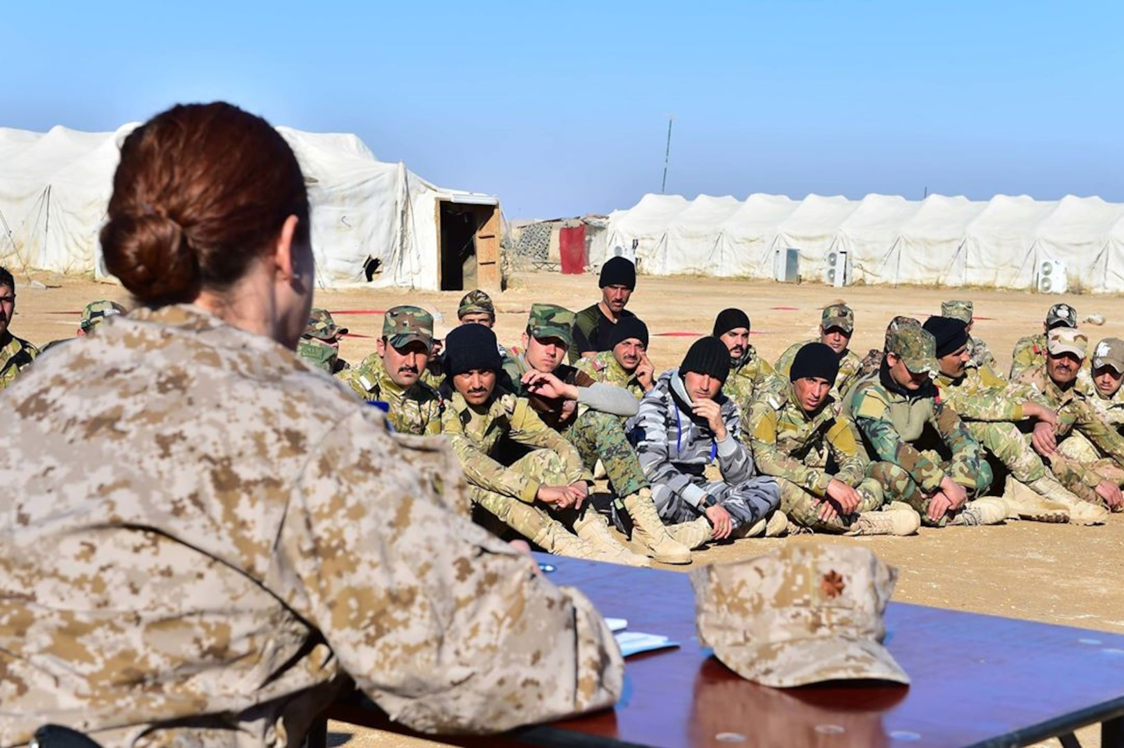 U.S. Navy Lt. Cmdr. Erin M. Baxter-Haynes, a Judge Advocate from Naval Special Warfare Command, assigned as the Legal Special Projects Officer for a special operations command under Combined Joint Task Force - Operation Inherent Resolve, conducts a special Law of Armed Conflict (LOAC) and rules of engagement (ROE) training for the first graduating company at a unique, multi-tribe Iraqi force, the A'ali Al Furat Brigade, at a training ground in Western Iraq, Jan. 4, 2017. The A'ali Al Furat Brigade, which has nearly 200 fighters from more than 20 tribes - the first multi-tribe unit formed in Iraq, is the first recorded tribal unit to receive LOAC and ROE training specifically from a U.S. attorney through coordination with Coalition partners. CJTF-OIR is the global Coalition to defeat ISIS in Iraq and Syria.