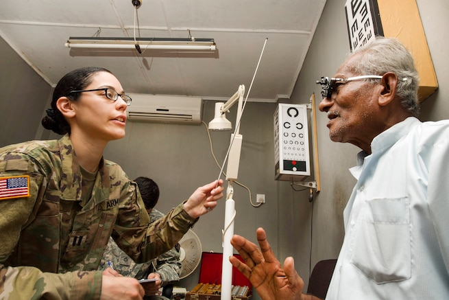 Army Capt. Frances M. Silva gives an eye exam to a patient at District General Hospital Hambantota as part of Pacific Partnership 2017 in Hambantota, Sri Lanka, March 8, 2017. Pacific Partnership is the largest annual multilateral humanitarian assistance and disaster relief preparedness mission conducted in the Indo-Asia-Pacific and aims to enhance regional coordination in areas such as medical readiness and preparedness for manmade and natural disasters. Navy photo by Petty Officer 2nd Class Chelsea Troy Milburn