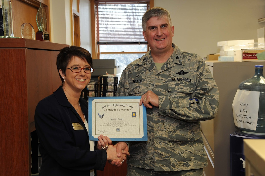 Nettie Webb, 22nd Force Support Squadron civilian personnel officer, poses with Col. Albert Miller, 22nd Air Refueling Wing commander, March 9, 2017, at McConnell Air Force Base, Kan. Webb received the spotlight performer for the week of Jan. 30 – Feb. 3. (U.S. Air Force photo/Airman 1st Class Jenna K. Caldwell)