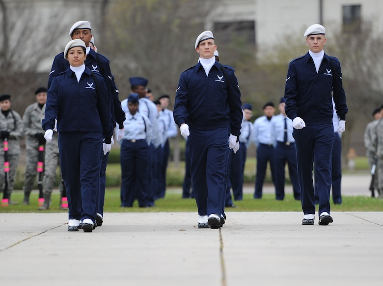 "Members of the 334th Training Squadron regulation drill team perform during the 81st Training Group drill down at the Levitow Training Support Facility drill pad March 10, 2017, on Keesler Air Force Base, Miss. Airmen from the 81st TRG competed in a quarterly open ranks inspection, regulation drill routine and freestyle drill routine with the 334th TRS ""Gators"" taking first place. (U.S. Air Force photo by Kemberly Groue)"