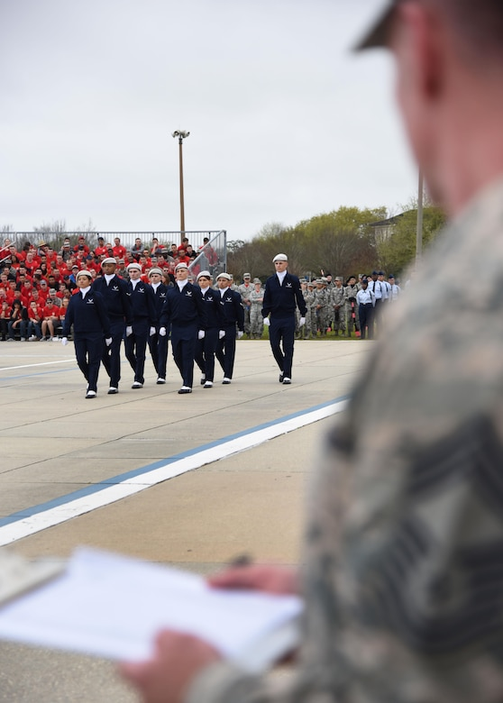 "Members of the 334th Training Squadron regulation drill team perform during the 81st Training Group drill down at the Levitow Training Support Facility drill pad March 10, 2017, on Keesler Air Force Base, Miss. Airmen from the 81st Training Group competed in a quarterly open ranks inspection, regulation drill routine and freestyle drill routine with the 334th TRS ""Gators"" taking first place. (U.S. Air Force photo by Kemberly Groue)"