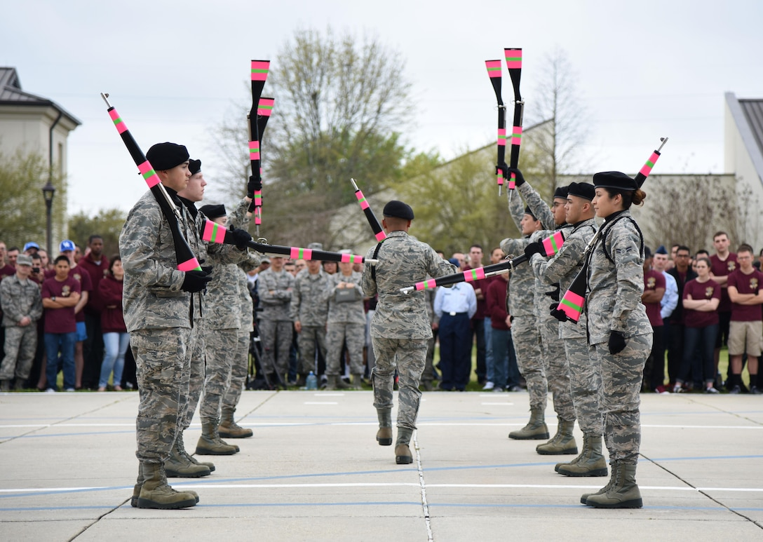 "Members of the 334th Training Squadron freestyle drill team perform during the 81st Training Group drill down at the Levitow Training Support Facility drill pad March 10, 2017, on Keesler Air Force Base, Miss. Airmen from the 81st TRG competed in a quarterly open ranks inspection, regulation drill routine and freestyle drill routine with the 334th TRS ""Gators"" taking first place. (U.S. Air Force photo by Kemberly Groue)"