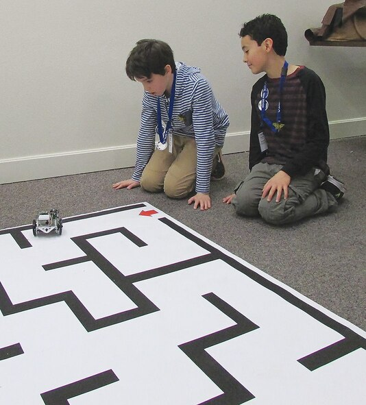 Kieran Ercolino and Kieran Vollmar from the New Mexico School for the Deaf prepare their robot for the practice course of the black maze during the Air Force Research Laboratory La Luz Academy's Robotics Challenge Expo on March 2 at Kirtland Air Force Base.