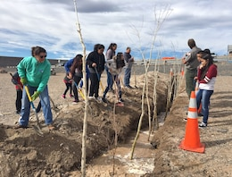 COCHITI LAKE, N.M. – Park rangers and volunteers from Cochiti Elementary School plant cottonwood poles and willows at the lake, Feb. 17, 2017.