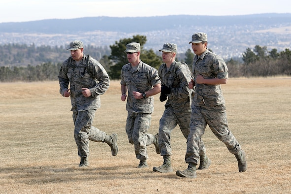 "Freshmen cadets run during Recognition, March 10, 2017, at the U.S. Air Force Academy. Recognition is a rigorous annual event freshmen, or ""four degrees,"" must navigate before earning the status of ""recognized cadet."" (U.S. Air Force photo/Darcie Ibidapo)"