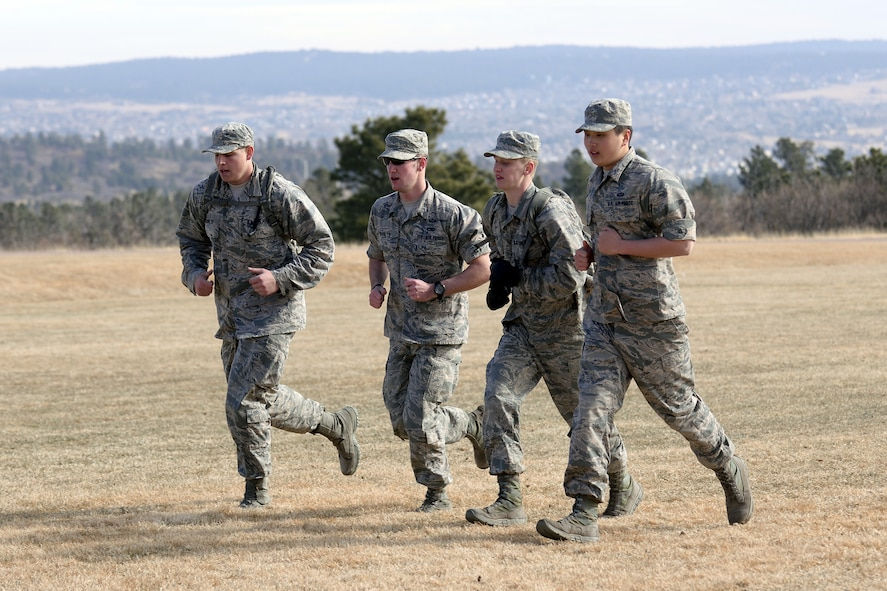 "Freshmen cadets run during Recognition, March 10, 2017 at the U.S. Air Force Academy. Recognition is a rigorous annual event freshmen, or ""four degrees,"" must navigate before earning the status of ""recognized cadet."" (U.S. Air Force photo/Darcie Ibidapo)"