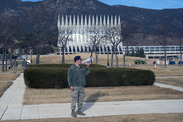 "A senior cadet at the U.S. Air Force Academy, Colorado, uses a megaphone to get the attention of freshmen cadets, March 10, 2017, during Recognition. Recognition is a rigorous annual event freshmen or ""four degrees"" must overcome before earning the status of ""recognized cadet"" at the Academy.  (U.S. Air Force photo/Bill Evans)"