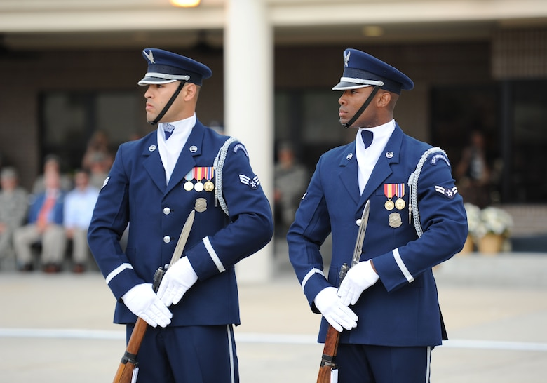 Senior Airman Ryan Garrido and Airman 1st Class Nigel Jaggard, U.S. Air Force Honor Guard Drill Team members, debut their 2017 routine during the 81st Training Group drill down at the Levitow Training Support Facility drill pad March 10, 2017, on Keesler Air Force Base, Miss. The team comes to Keesler every year for five weeks to develop a new routine that they will use throughout the year. (U.S. Air Force photo by Kemberly Groue)