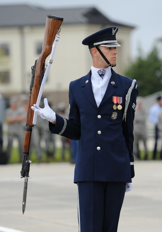 Senior Airman Joshua Blanton, U.S. Air Force Honor Guard Drill Team member, spins a rifle while debuting  the team's 2017 routine during the 81st Training Group drill down at the Levitow Training Support Facility drill pad March 10, 2017, on Keesler Air Force Base, Miss. The team comes to Keesler every year for five weeks to develop a new routine that they will use throughout the year. (U.S. Air Force photo by Kemberly Groue)